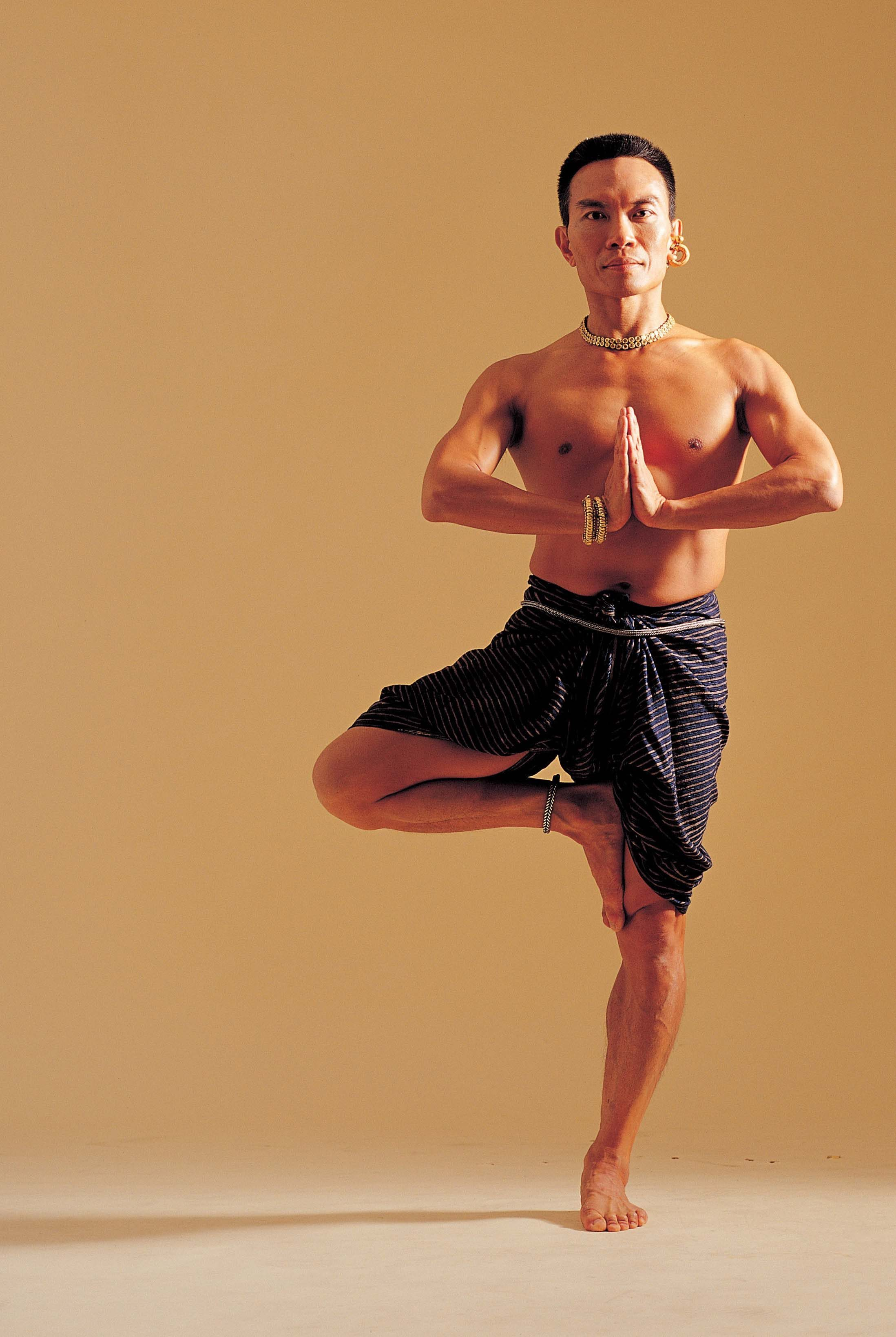 John Ang does exercises as part of yoga practice in what he sees as a journey to try to understand himself.