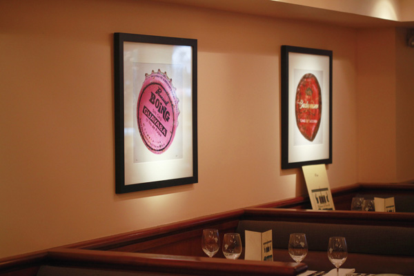 The old artwork at Maloney & Porcelli, a chophouse founded in 1996, in New York, March 21, 2012. (The New York Times)