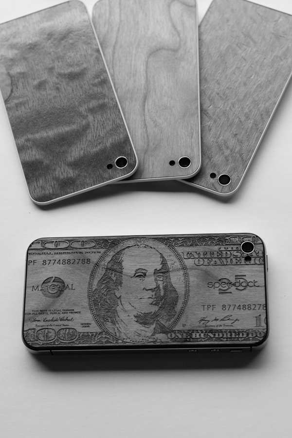 Wooden backs for iPhones from the shop Material6, in Tucker, Ga., March 22, 2012. (The New York Times)decommissioned euro notes in Dublin, March 20, 2...