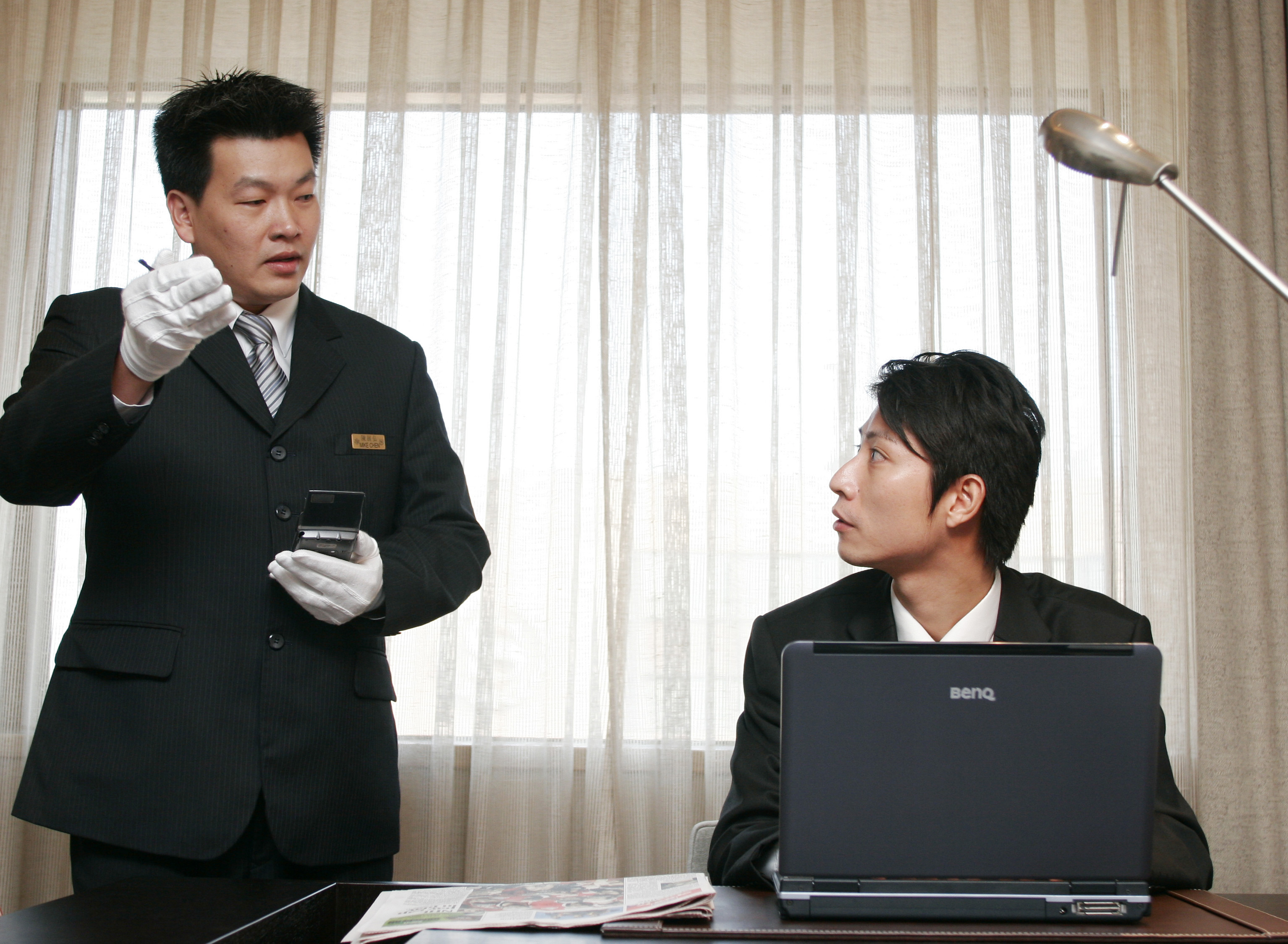 A executive butler from Sheraton Taipei does secretarial tasks for a guest at a press conference on Oct. 05, 2006.