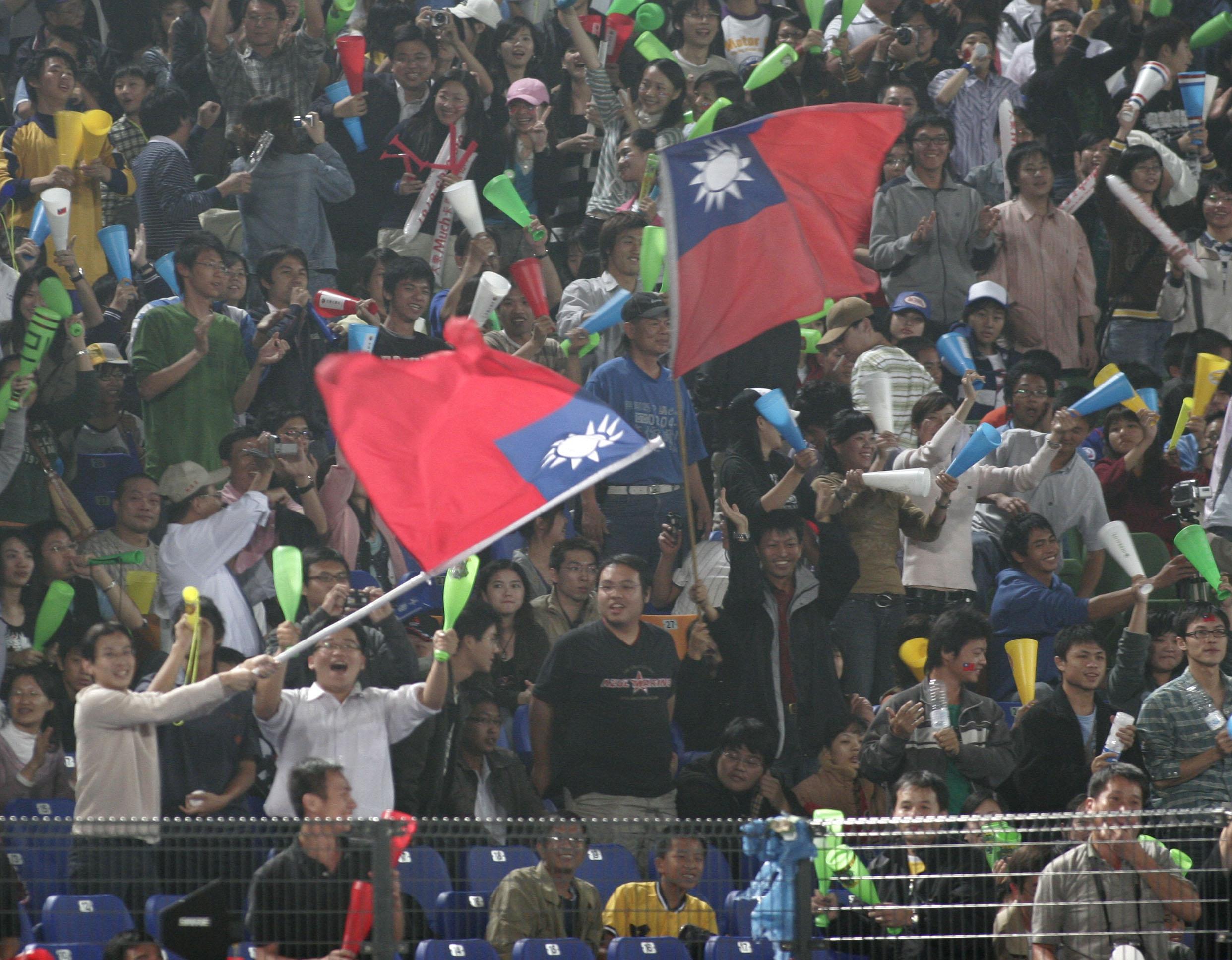 Taiwanese swing the national flags during the game Cuba and Taiwan for Intercontinental Cup Baseball Championships 16 November 2006. Taiwan beats Cuba...