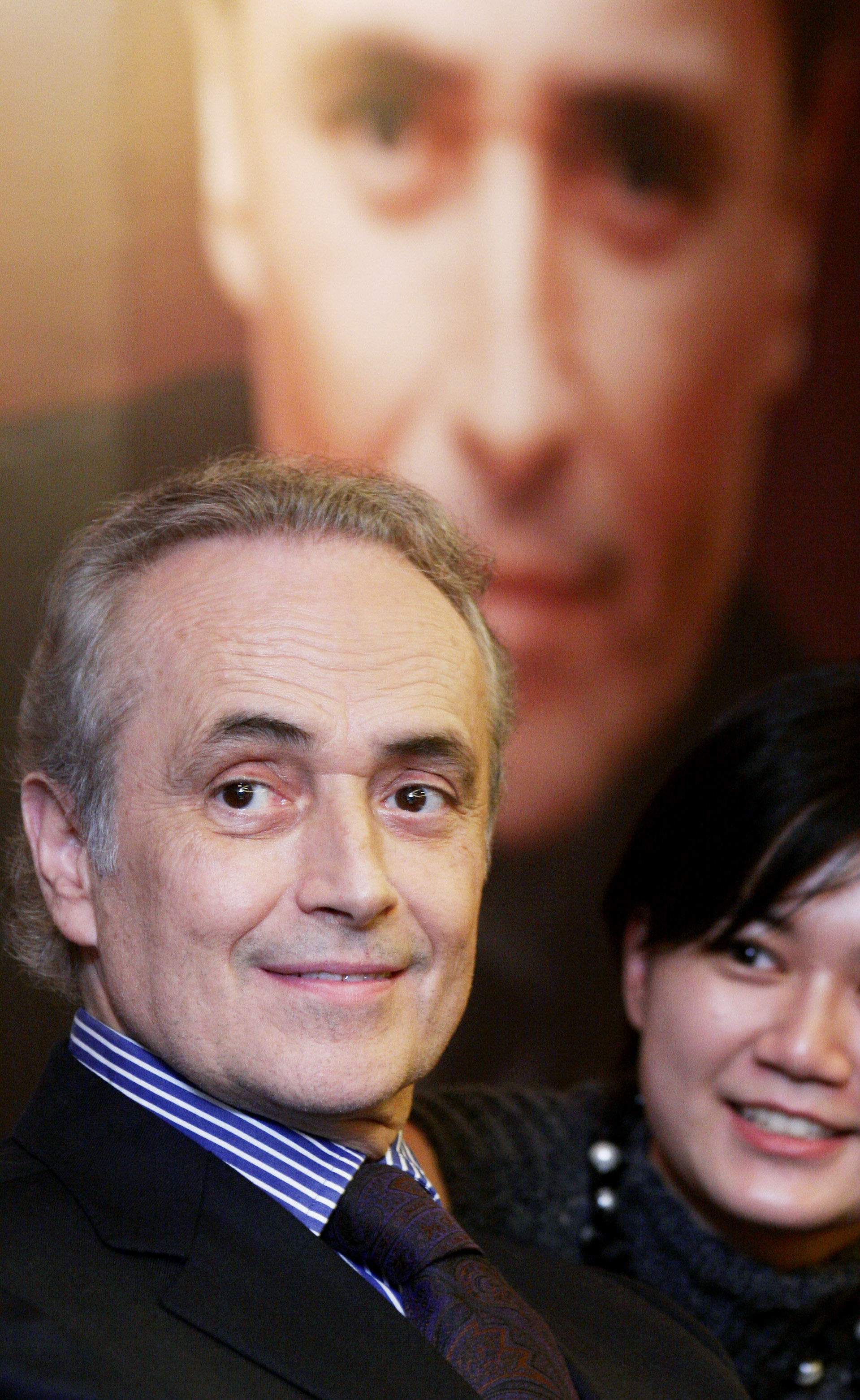 Spanish tenor Jose Carreras smiles during a news conference to promote his New Year's Eve concert in Taipei December 28, 2006.