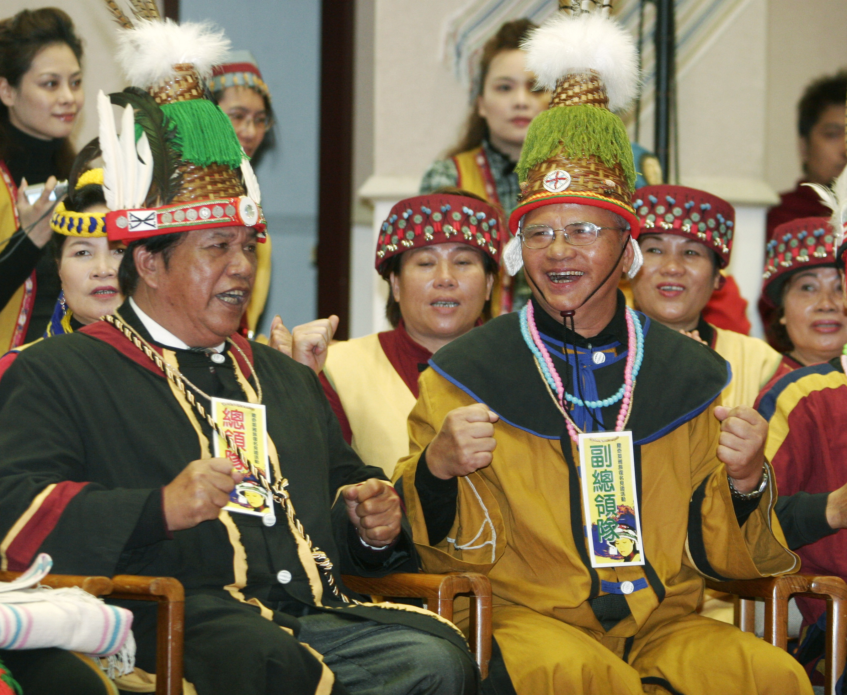 People of the Sakizaya tribe react after the government officially announced that they would become Taiwan's 13th official indigenous tribe in Taipei ...