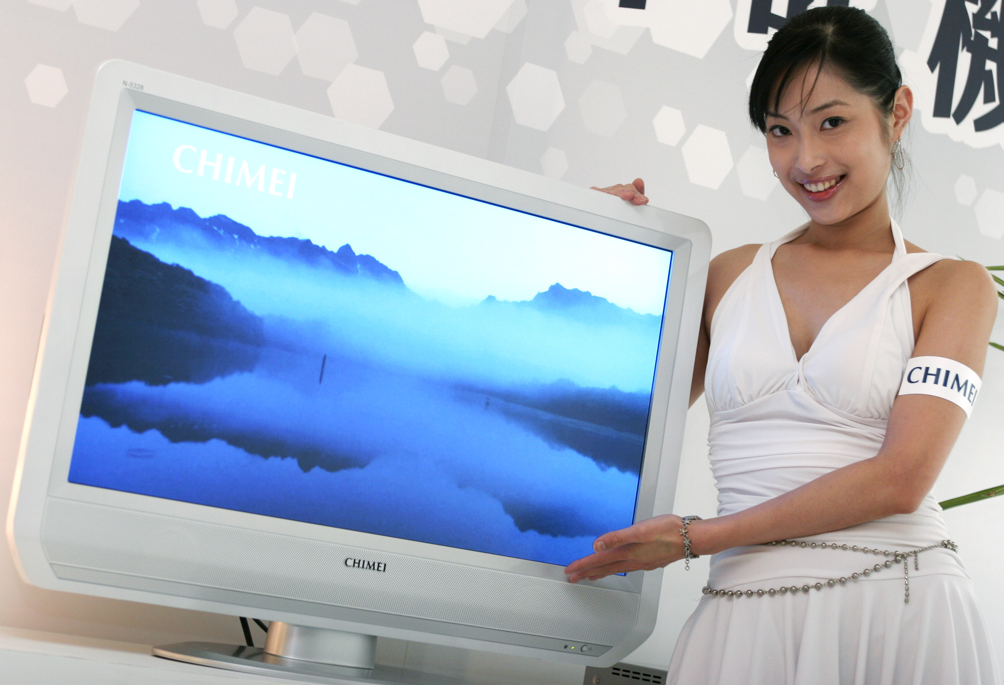 "A model displays a 32-inch liquid crystal display (LCD) television"" Snow White"" released on Jan. 24 by Chi Mei Optoelectronics. They sell only 800  pi..."