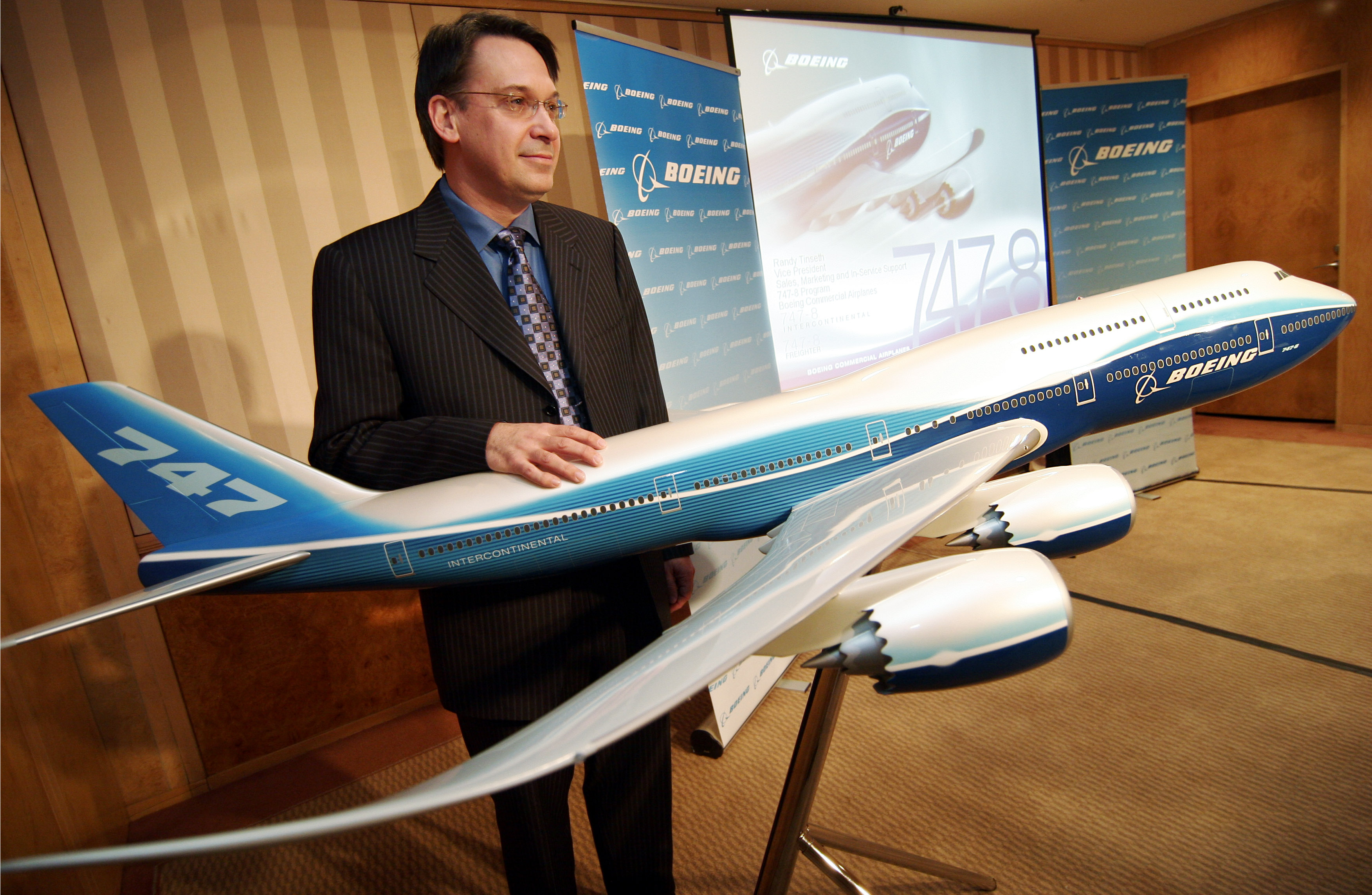 Randy Tinseth, Boeing Commercial Airplanes vice president- Sales, Marketing and In-Services Support, 747 Programs, poses with a scale model of the Boe...