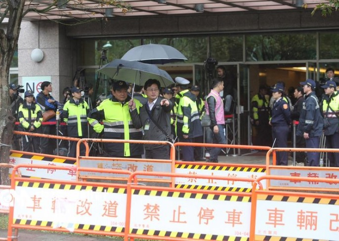 Security remains heightened as police begins to barricade the perimeter of the PTS building Sunday morning prior to opening of the televised election ...