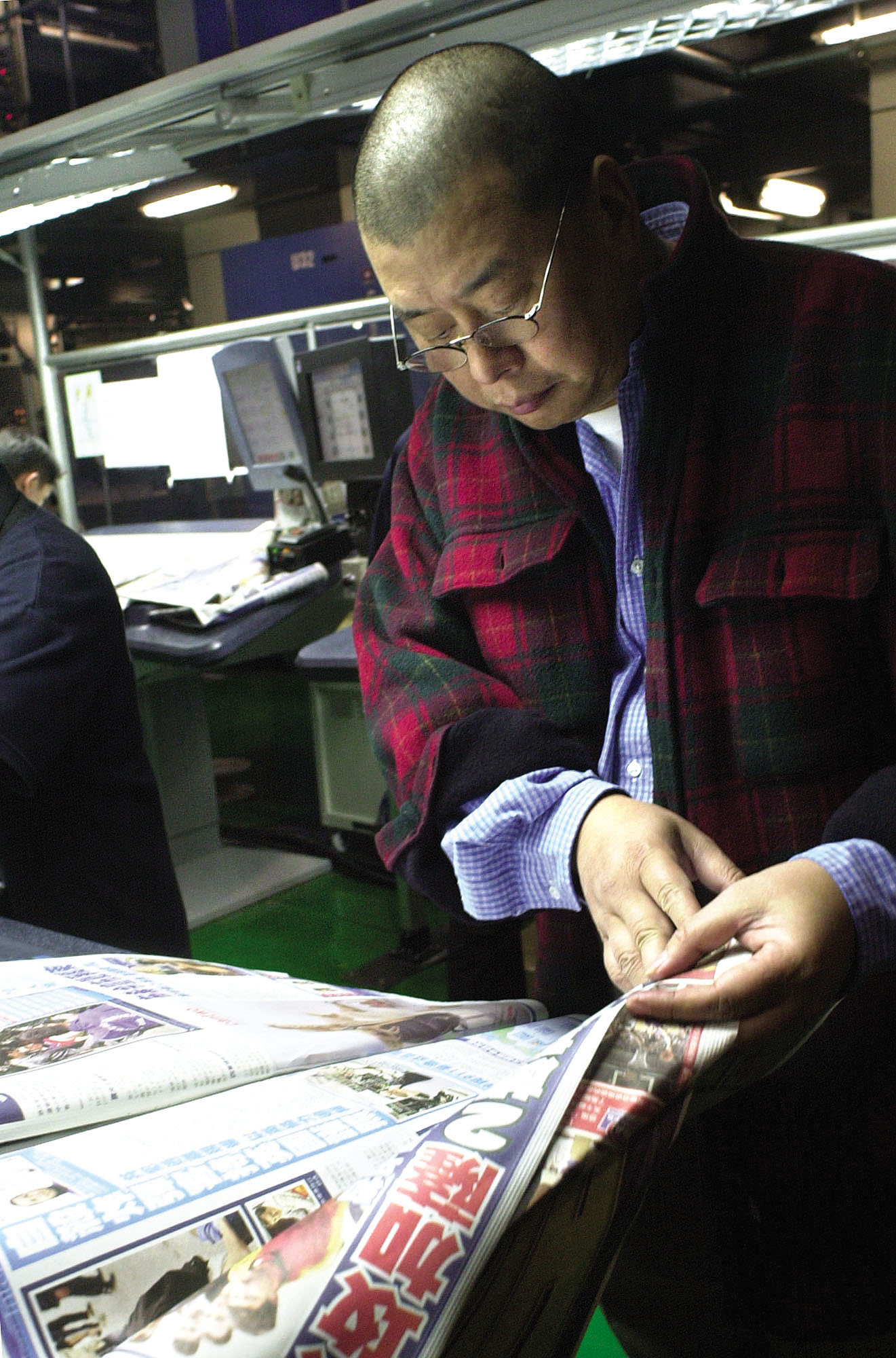 Hong Kong media tycoon Jimmy Lai is pictured reading the Apple Daily, a Chinese-language newspaper under Hong Kong's Next Media Ltd.