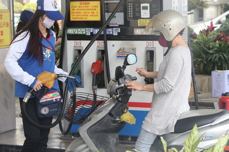 A scooter rider refuels at a CPC gas station in Taiwan.