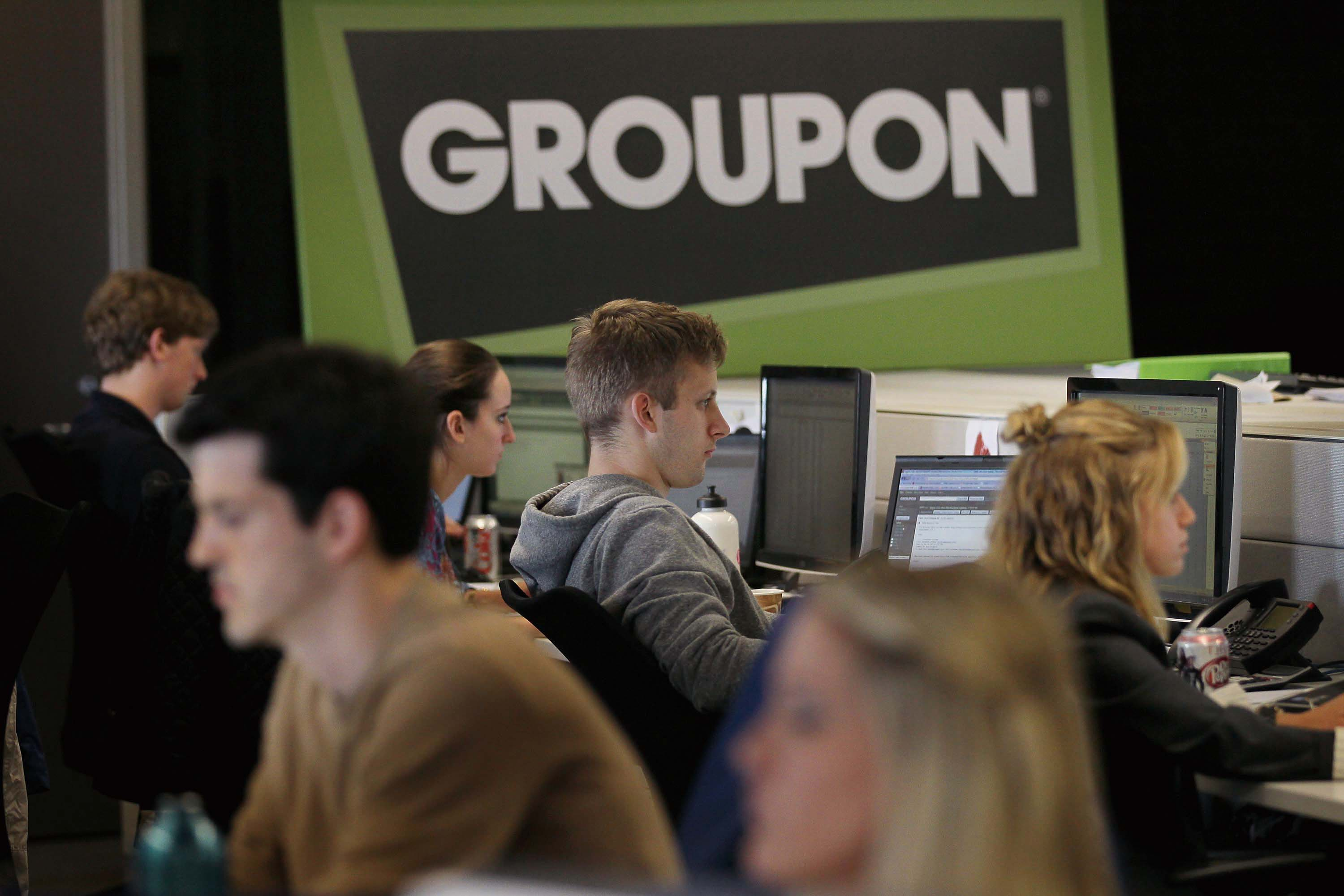 Workers work on projects at Groupons international headquarters on June 10, 2011 in Chicago, Illinois. Groupon is a local e-commerce marketplace that ...
