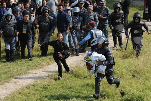Nepal police arrested more than 50 Tibetan exiles Tuesday as they demonstrated in support of monks from their homeland who have set themselves on fire...