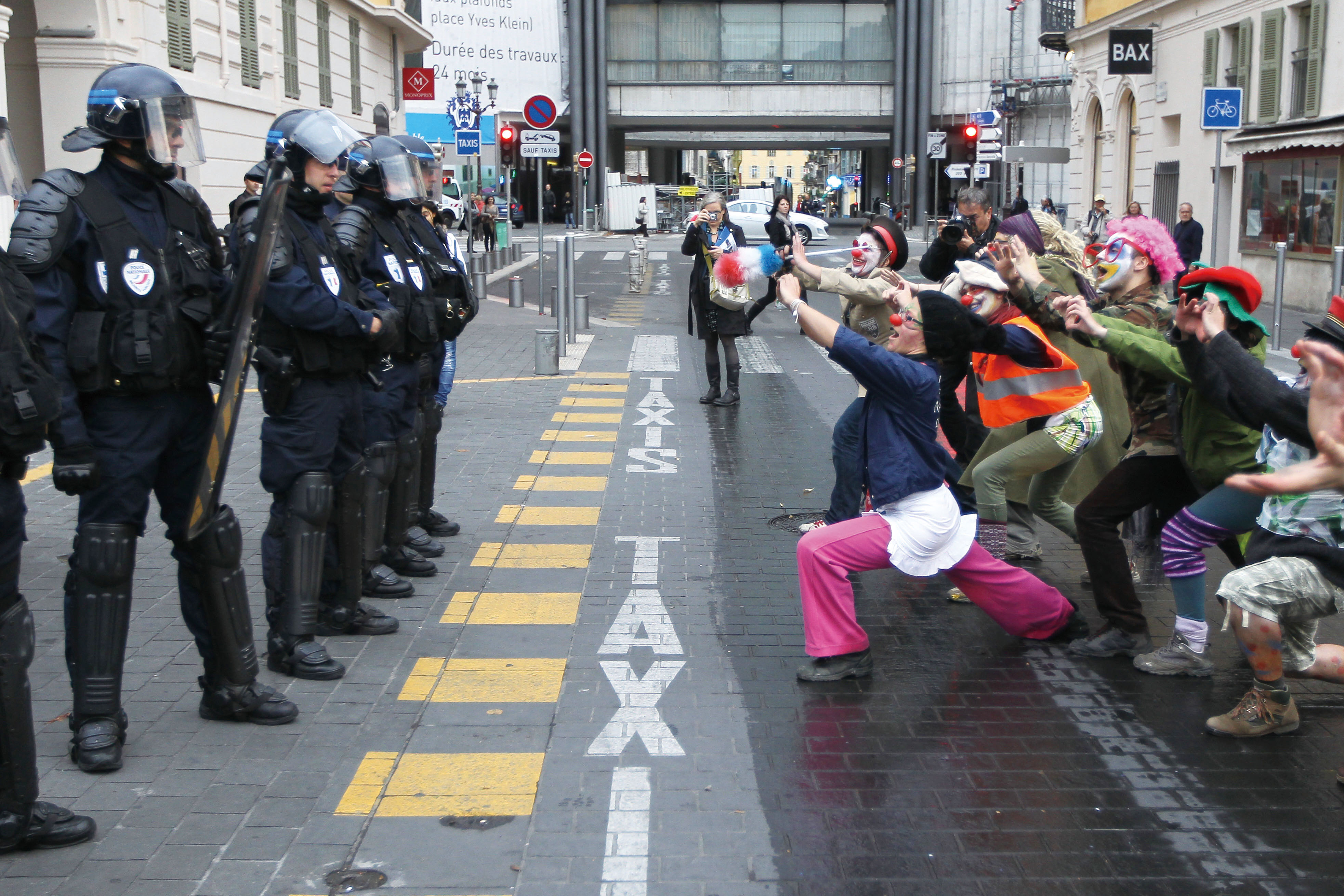 Demonstrators perform Kung Fu movements in front of policemen during a protest in Nice, on November 3, 2011. (Agence France-Presse)