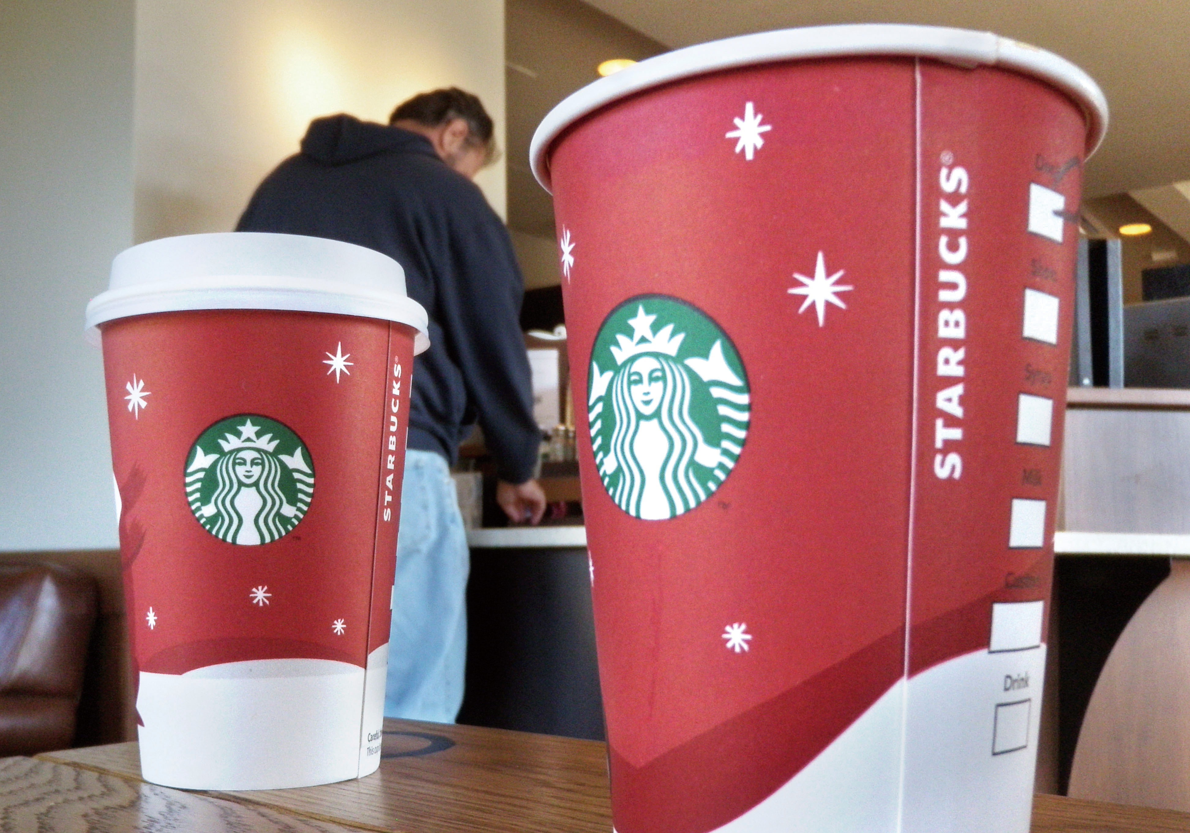 In this photo taken Nov.1, 2011, a customer waits for an order at a Little Rock, Ark. Starbucks Corp., reports quarterly financial results Thursday, N...
