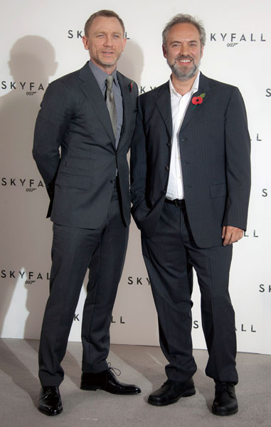 Director Sam Mendes, right, and actor Daniel Craig pose for photographs at the photo call for the new James Bond film titled Skyfall, at a central Lon...