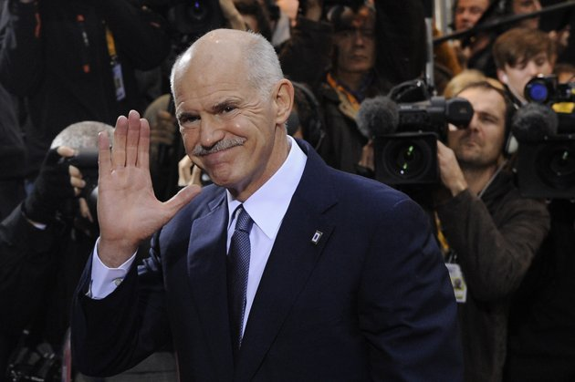 Greek Prime Minister George Papandreou reacts after winning a vote of confidence at Parliament in Athens, early on Saturday morning. Papandreou won th...