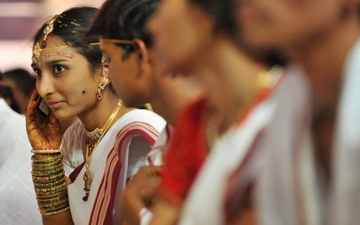 An Indian bride talks on her mobile phone. India aims to launch fourth-generation (4G) mobile services next year that will allow users to watch high-d...
