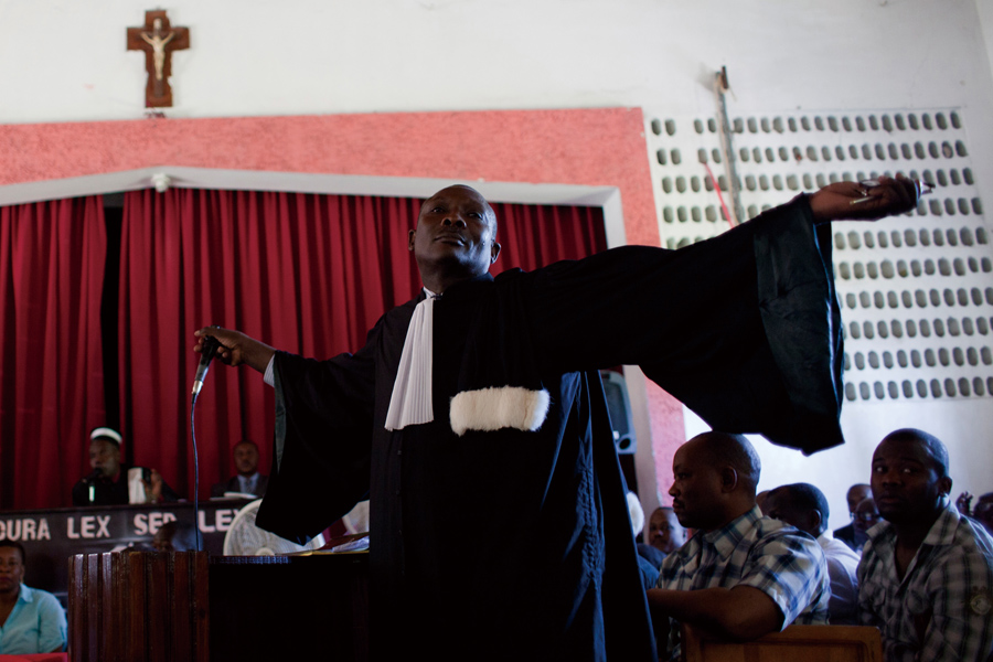 Defense attorney Jean Eugene Pierrre-Louis reacts during a trial of police officers, who are charged with murder or attempted murder in connection wit...