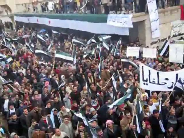An image grab taken from a video uploaded on YouTube shows anti-regime protesters rallying in Hama, central Syria, on Friday. AFP was not authorized t...