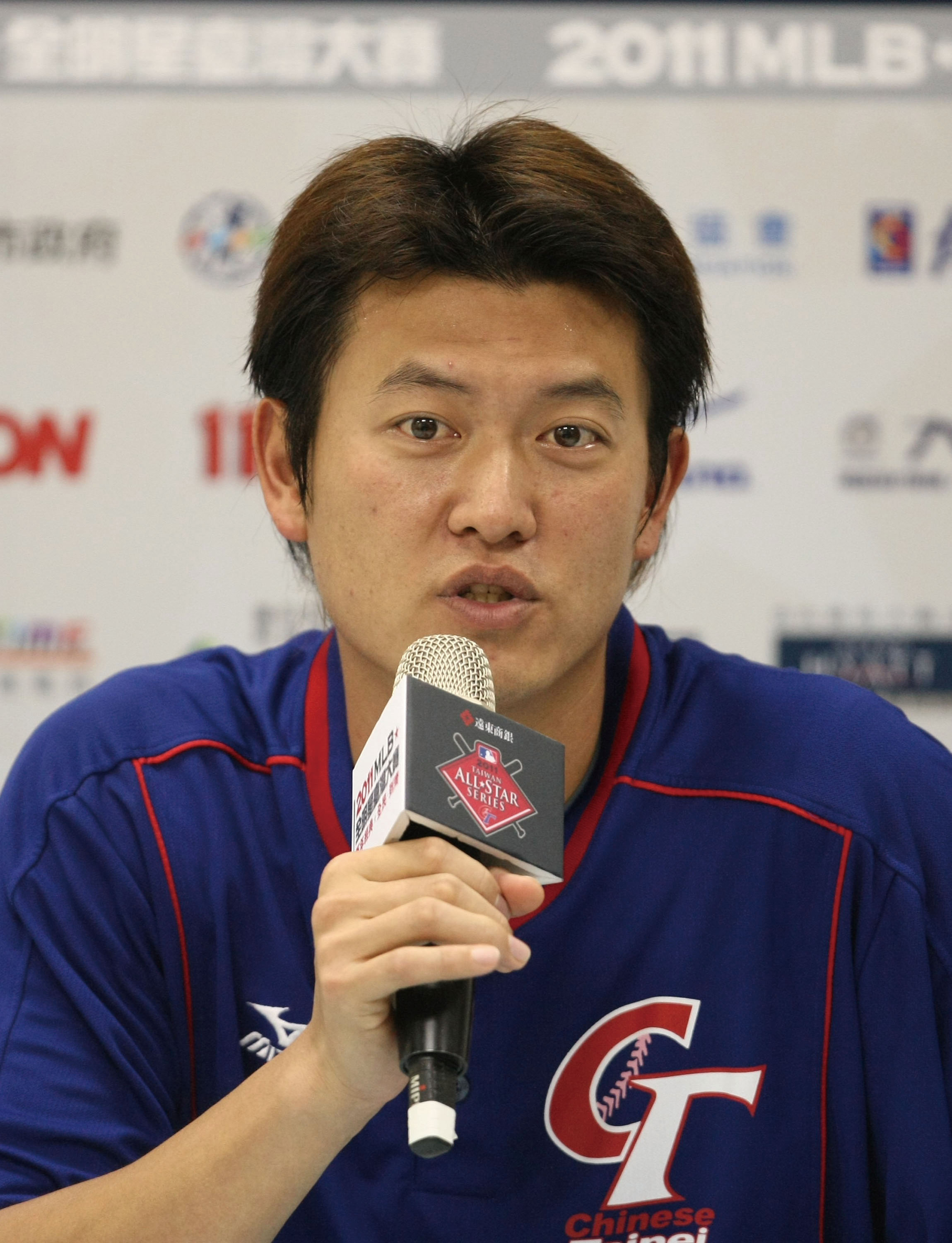 Taiwanese pitcher Chien-Ming Wang says he's happy and satisfied with his new one-year contract with the Washington Nationals at the news conference Sa...