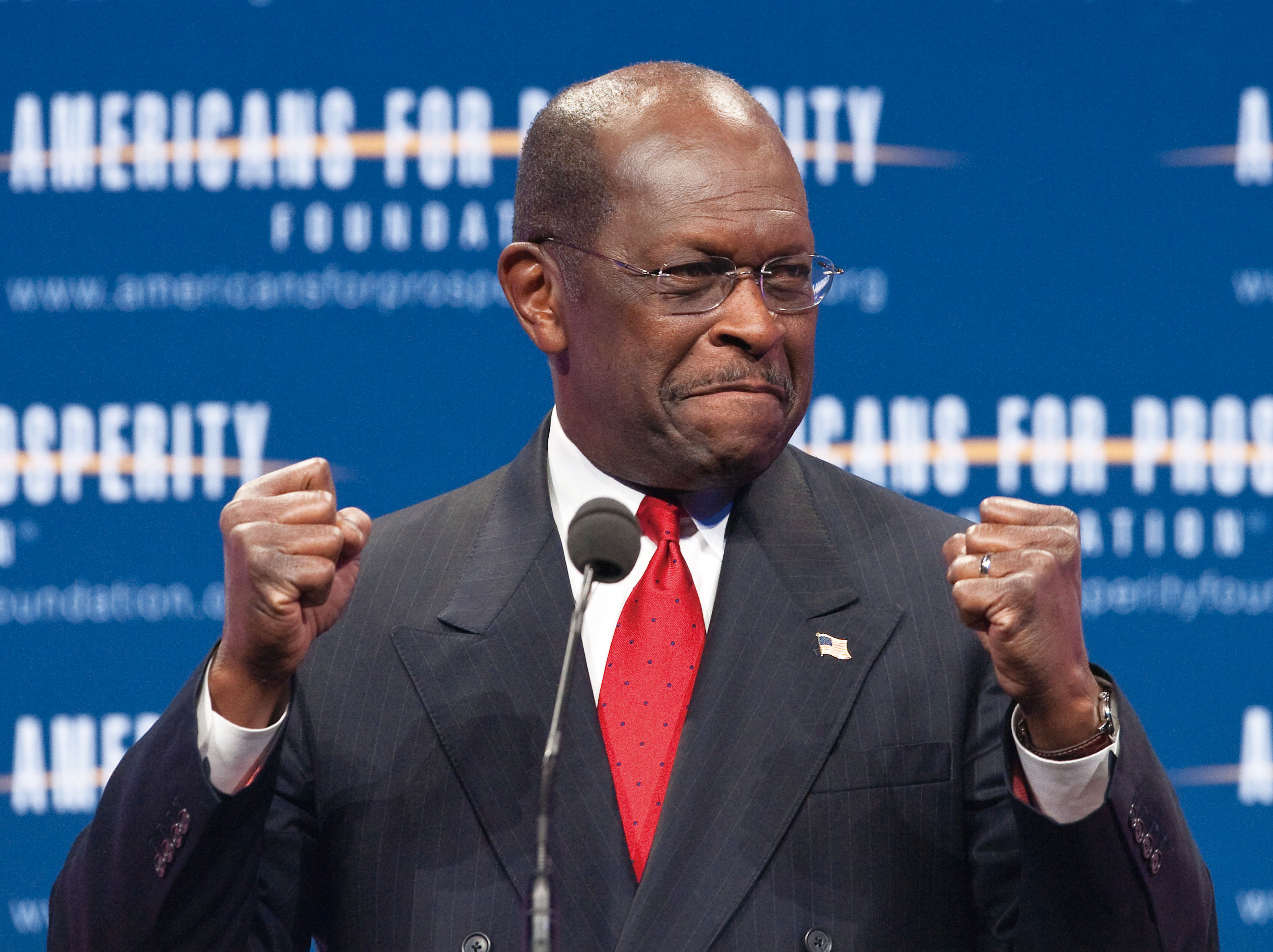 """US Republican presidential hopeful Herman Cain arrives to address the """"Defending The American Dream Summit"""" organized by the conservative Americans Fo..."""