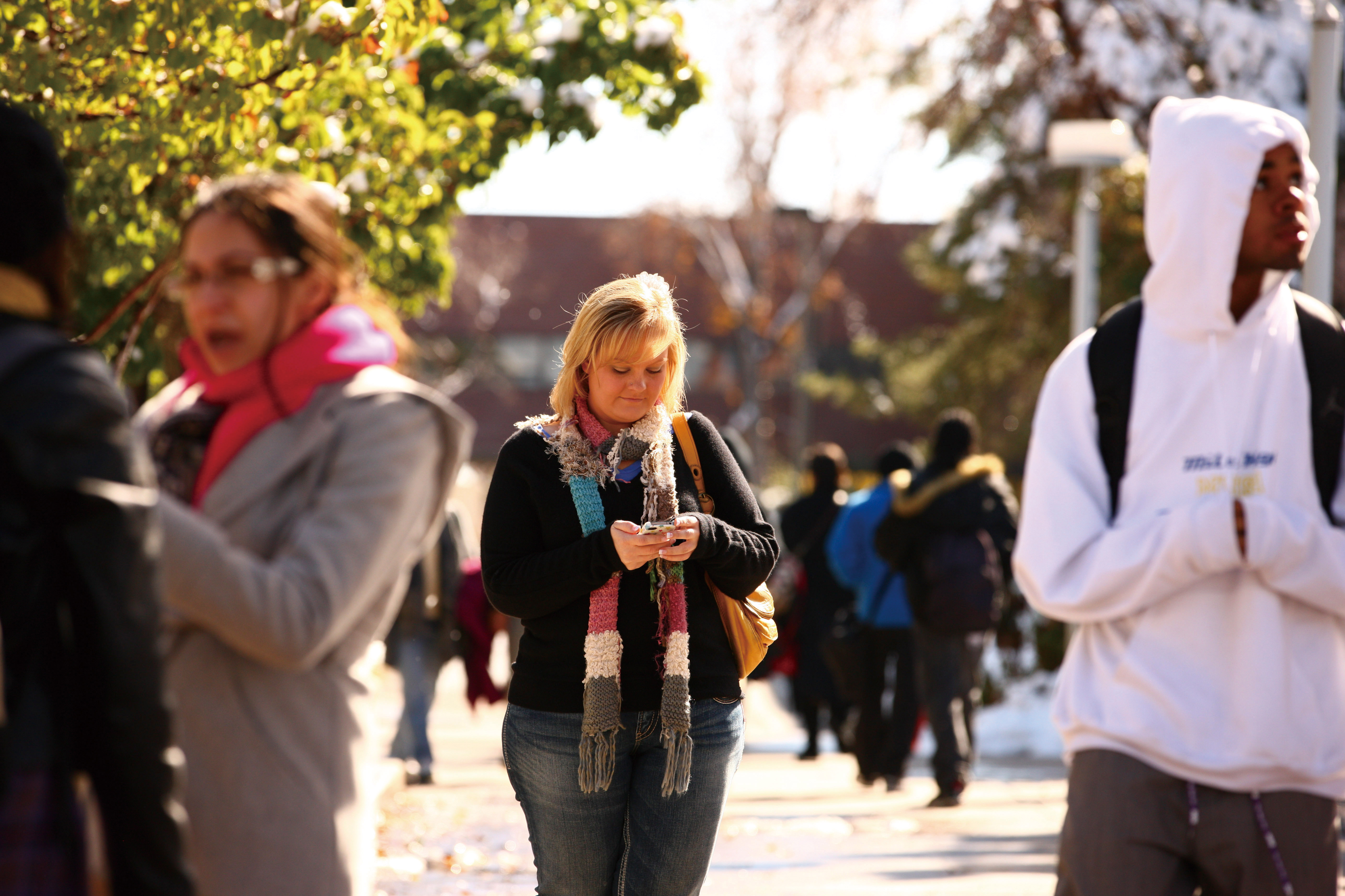 Shana Hensley, who said cellphone apps are convenient when looking for a date, looks at her phone in Denver, on Oct. 27, 2011. (The New York Times)
