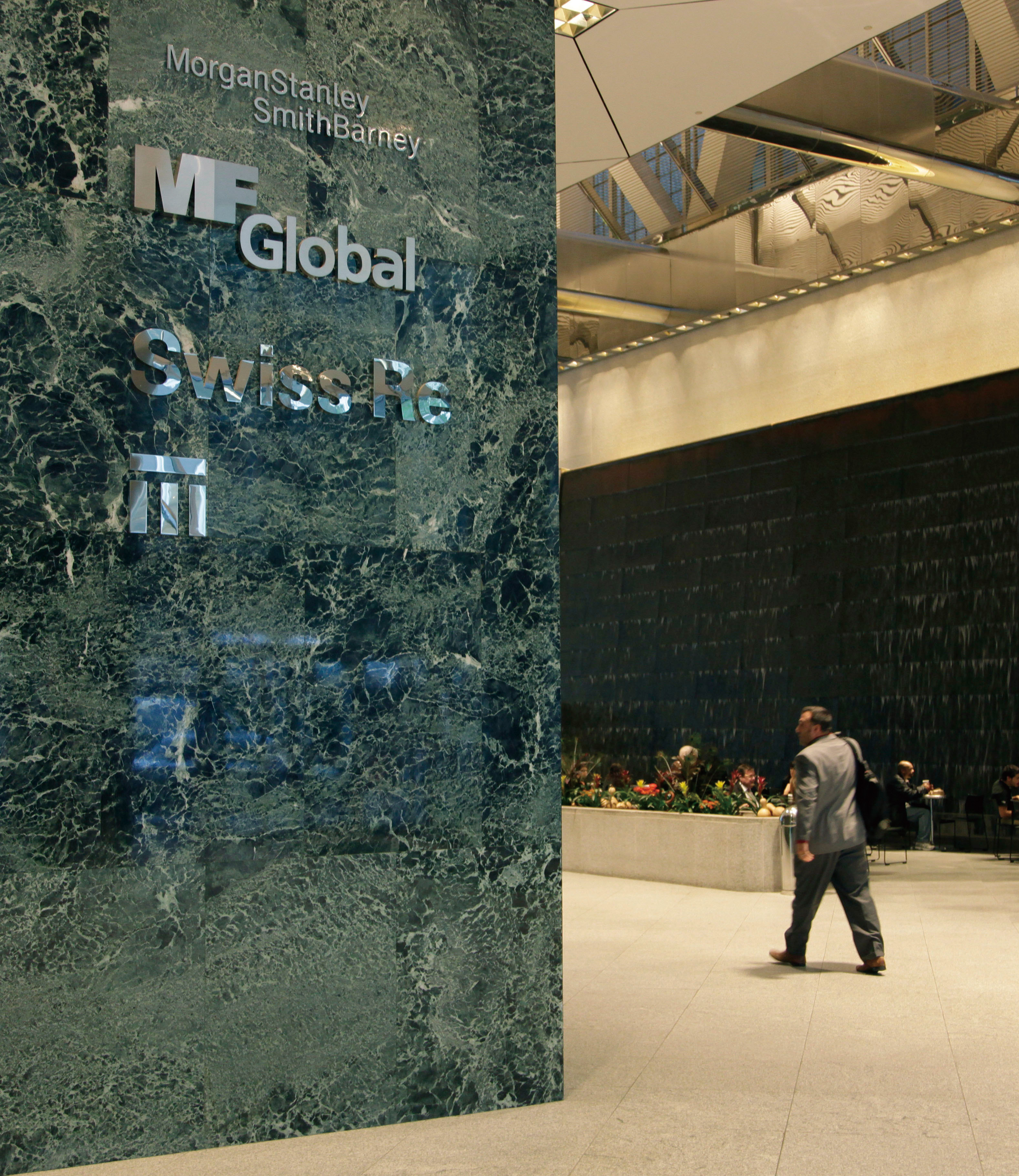A sign for MF Global is displayed at an office building, Nov. 2, 2011 in New York. MF Global, the securities firm led by Jon Corzine, admitted using c...