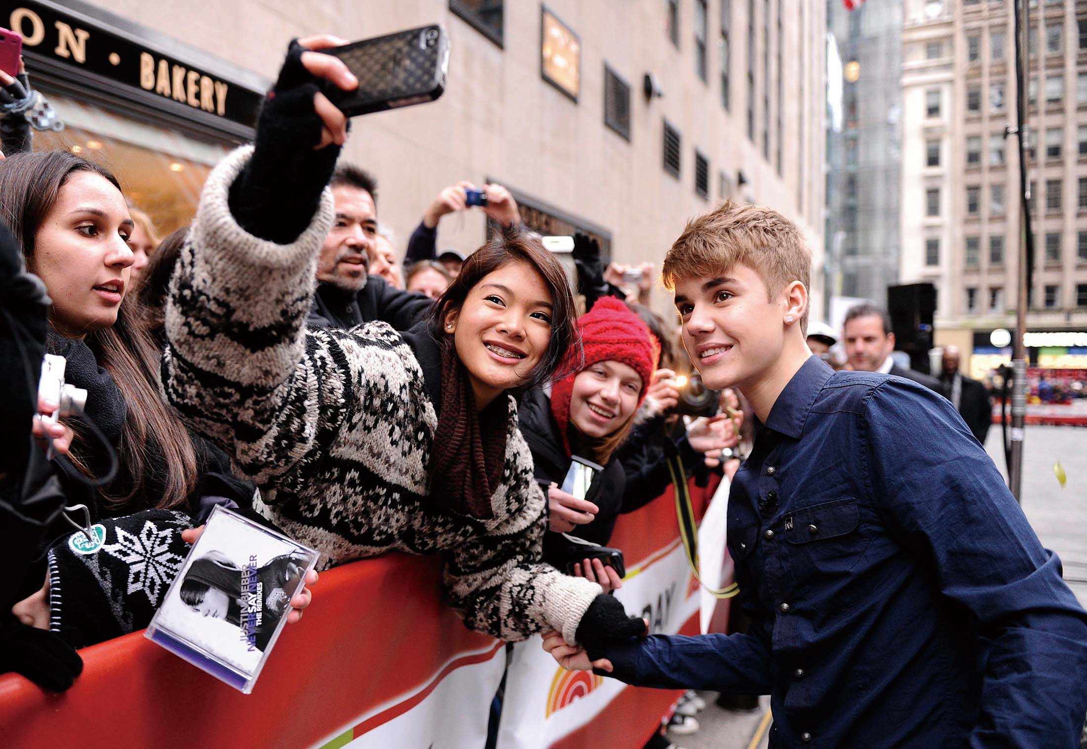 """In this image released by NBC, singer Justin Bieber poses with a fan as he makes an appearance to talk about his new CD """"Under The Mistletoe"""" on the """"..."""
