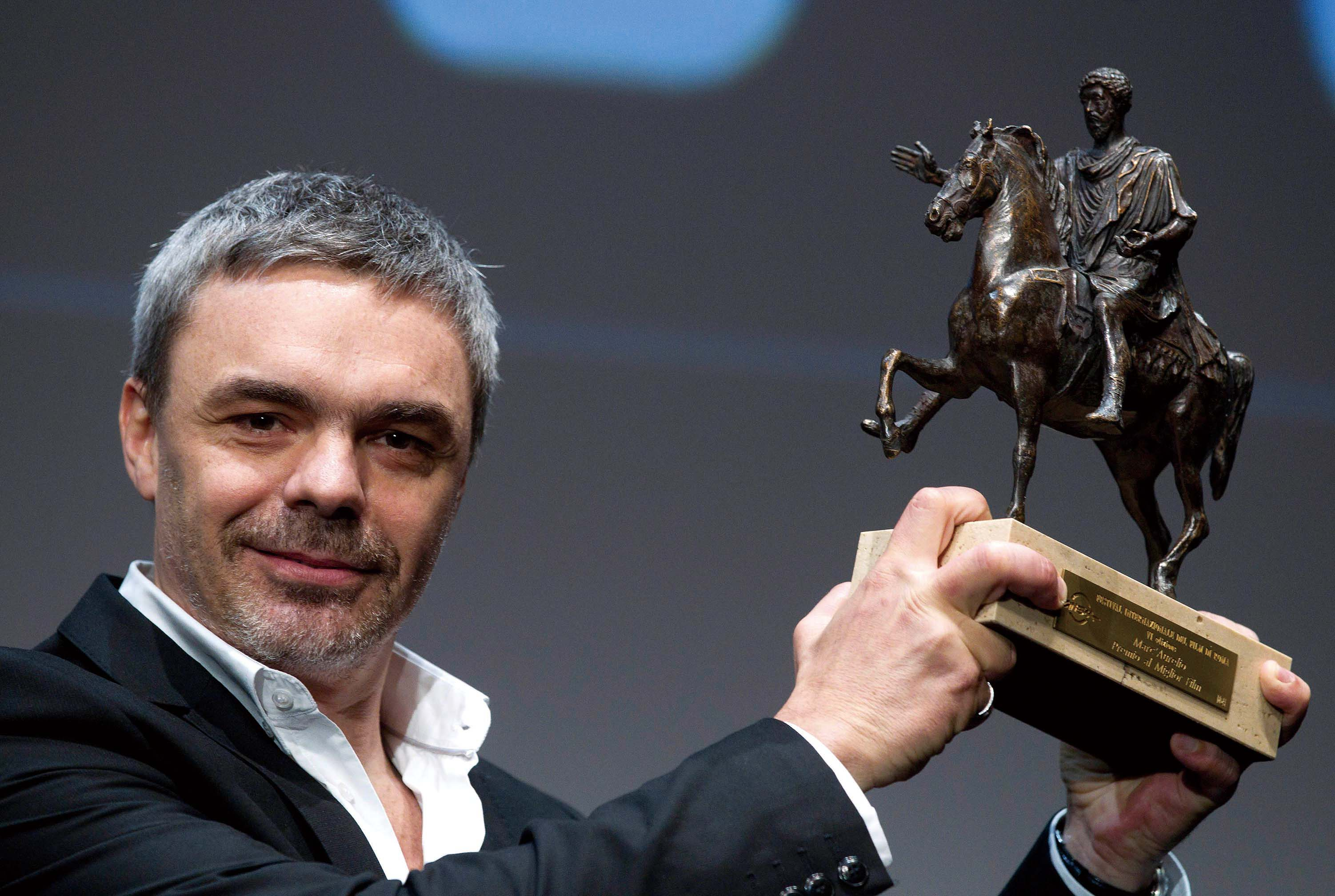 "Argentine director Sebastian Borensztein poses with the ""Marc'Aurelio"" best movie award of the 6th Rome International Film Festival, in Rome, Friday, ..."