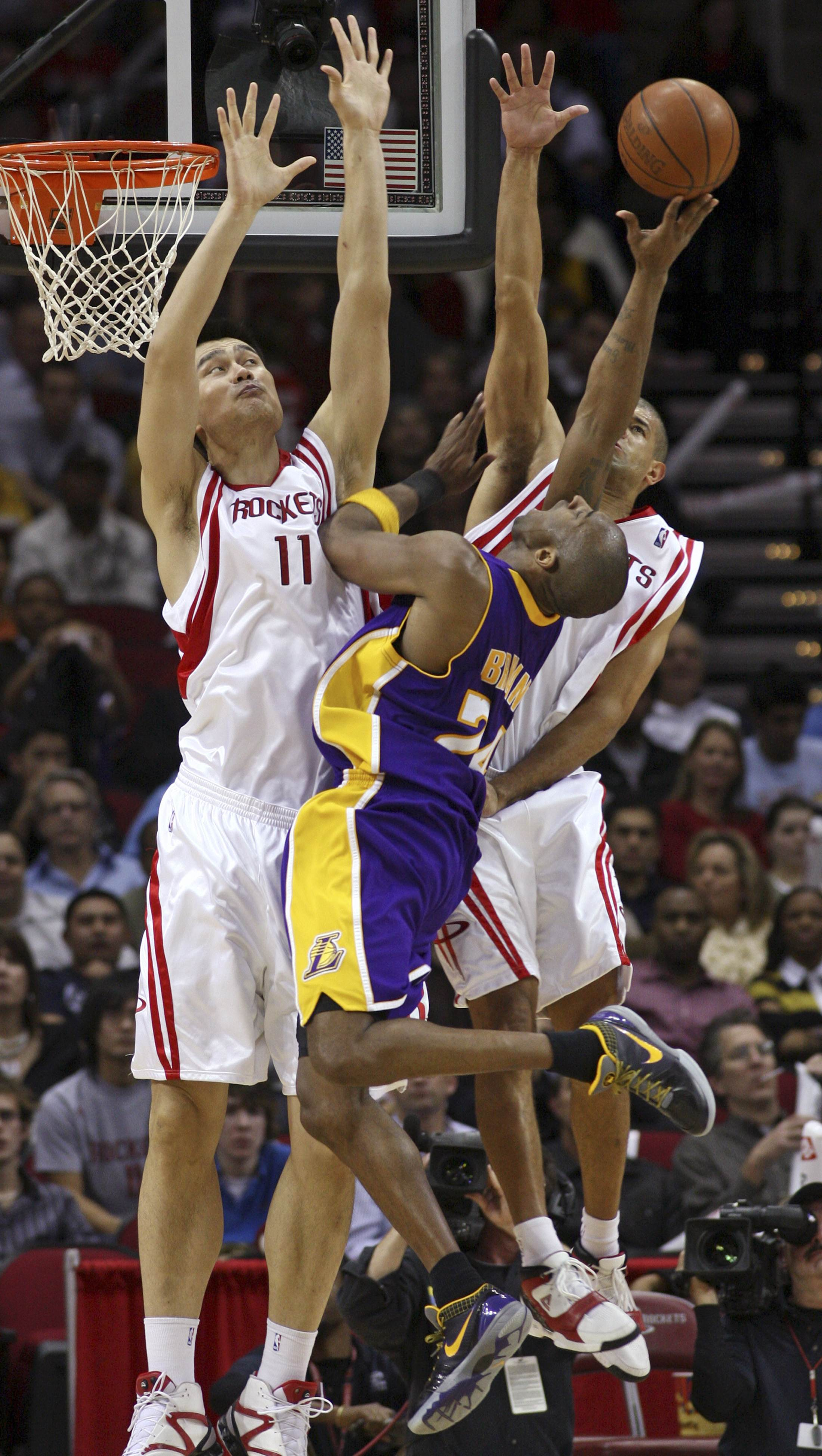 Houston Rockets center Yao Ming, left, and forward Shane Battier, right, team up to block the shot of Los Angeles Lakers guard Kobe Bryant during thei...