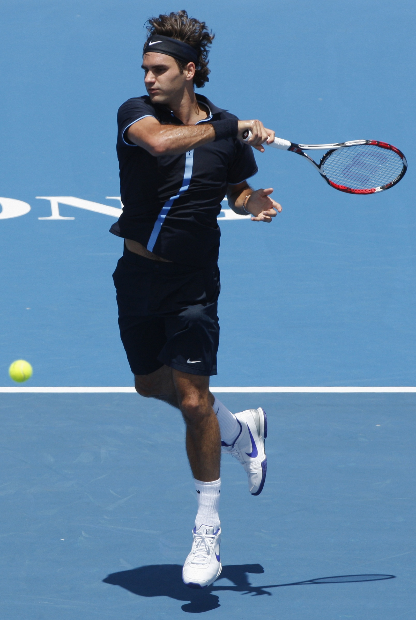 Switzerland's Roger Federer hits a forehand to Spain's Carlos Moya at the Kooyong Classic tennis tournament in Melbourne, Australia yesterday.