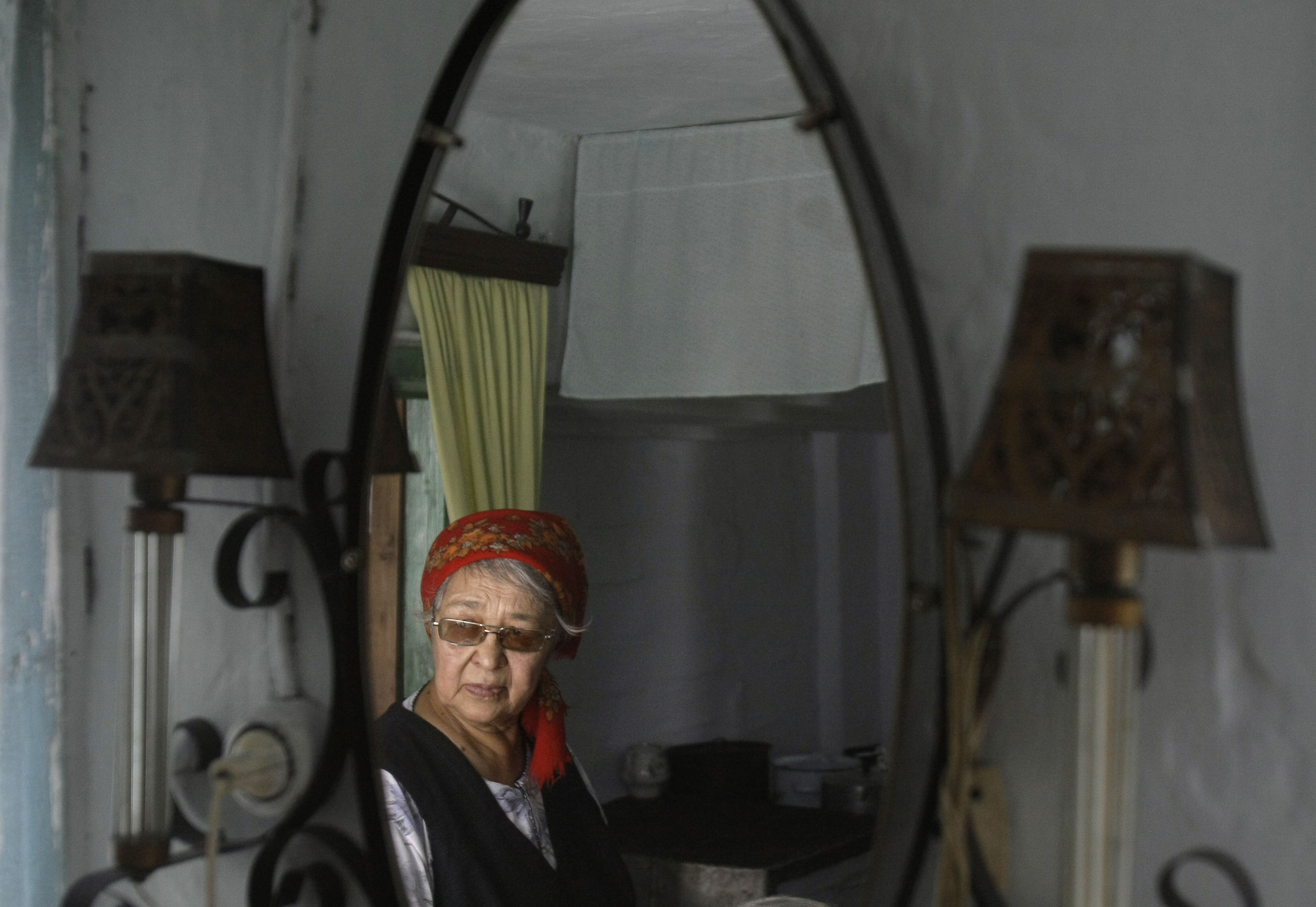 Rufina Aponkina stands in her house in the village of Chuvashka, Russia on Dec. 19, 2008.