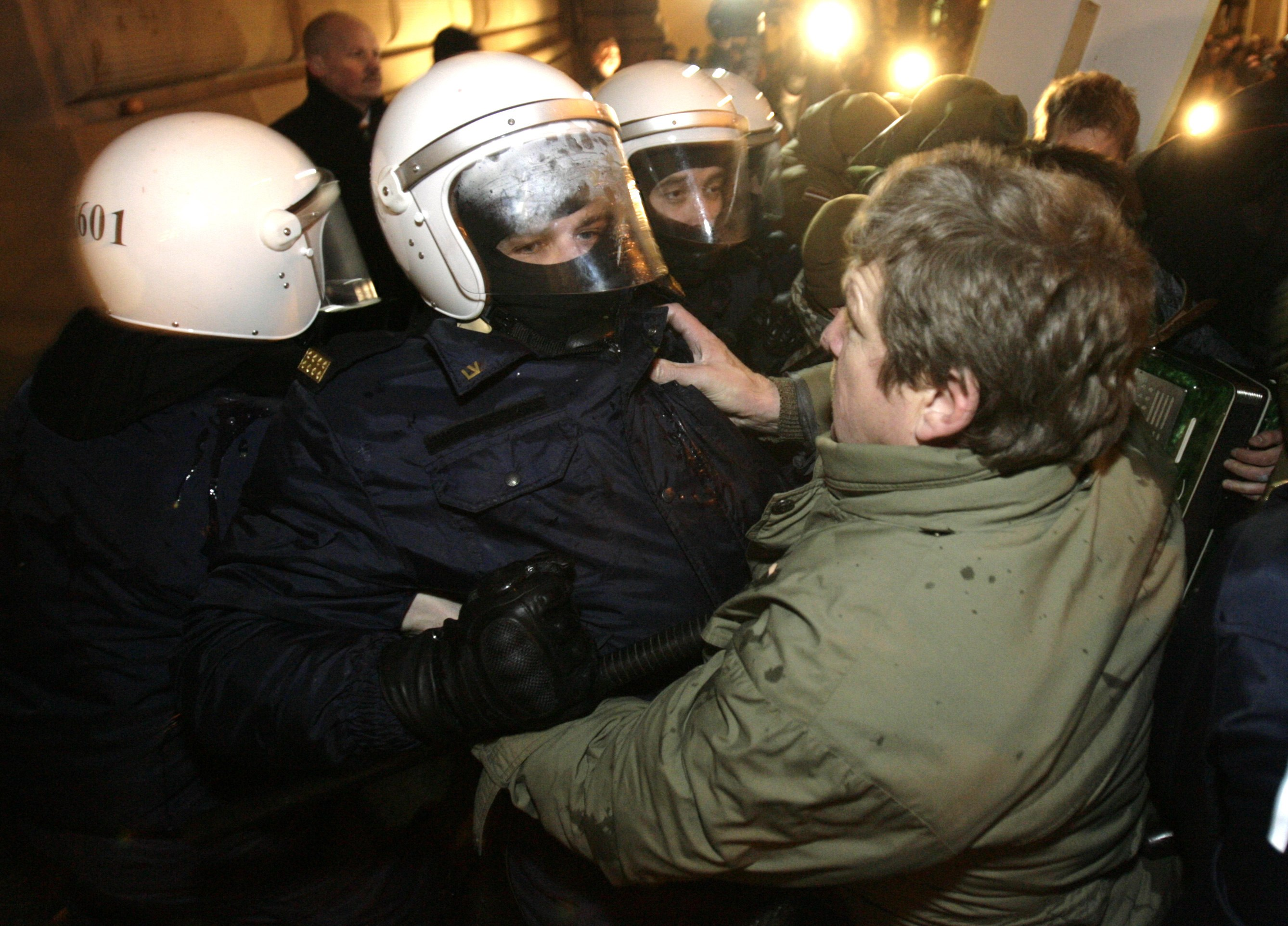 Demonstrators clash with riot police in front of Latvia's parliament building in Riga, Latvia on Tuesday.