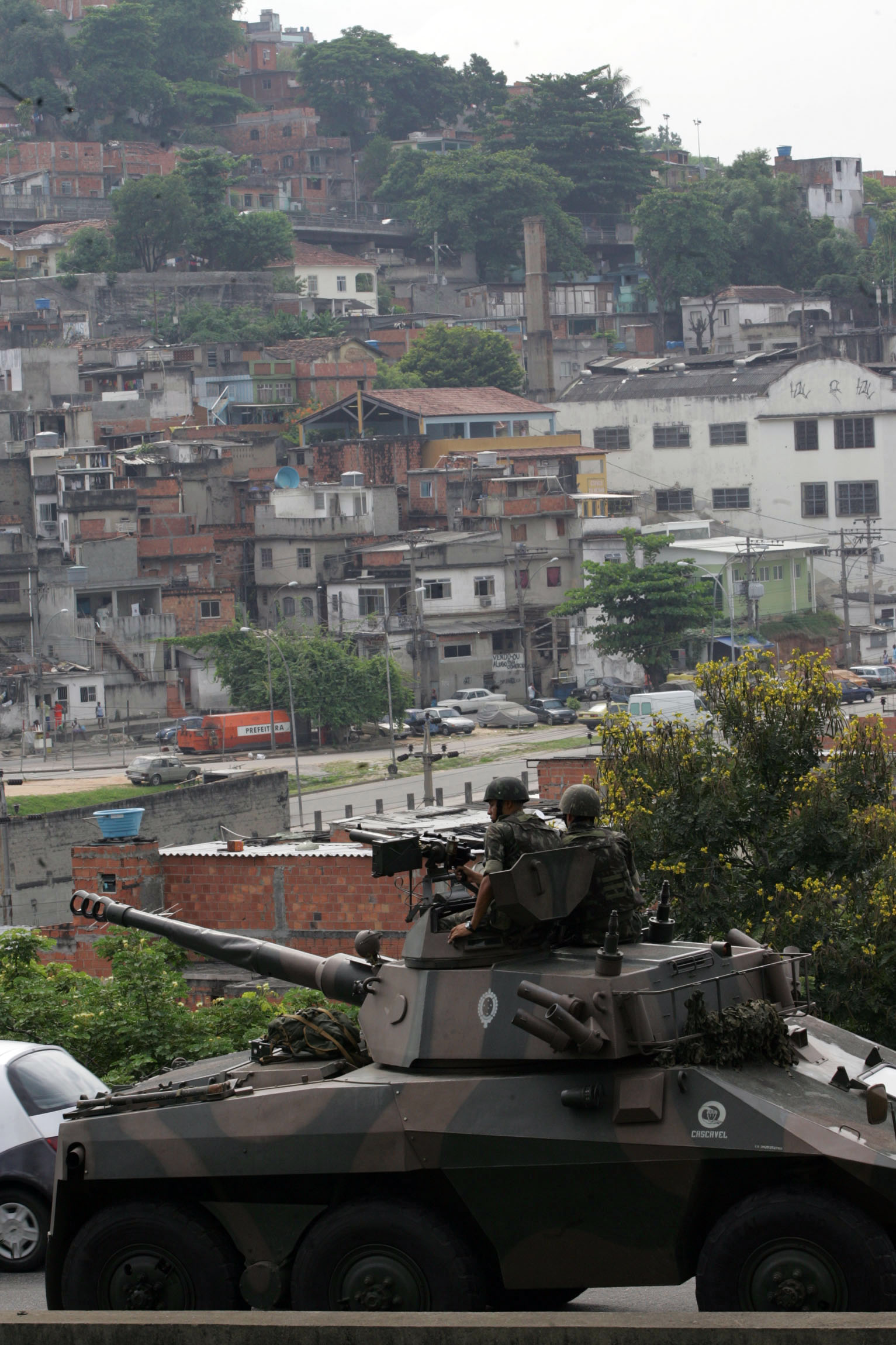 A tank sits at a checkpoint in front of Favela da Mangueira, near the Maracan Stadium in Rio de Janeiro, Brazil in this 2007 file photo. Brazil is aga...