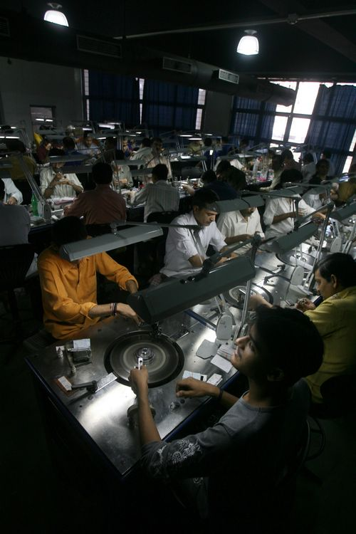 Employees work at a diamond cutting and polishing factory in Surat in the western Indian state of Gujarat on March 3.