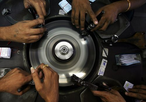 Employees work at a diamond cutting and polishing factory in the Surat in the western Indian state of Gujarat on March 3.