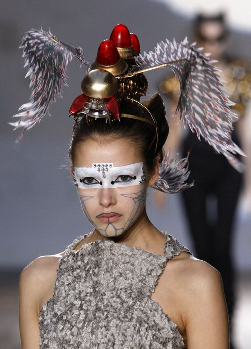 A model presents a creation by Indian designer Manish Arora as part of his Fall/Winter 2009/10 ready-to-wear fashion collection during Paris Fashion W...