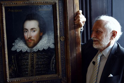 Chairman of The Shakespeare Birthplace Trust, Stanley Wells, poses for photographers with a newly discovered portrait of poet William Shakespeare at D...