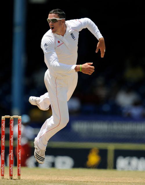England's Kevin Pietersen tries to stop a misdirected throw during the cricket test match against the West Indies at Queen's Park Oval, Port of Spain,...
