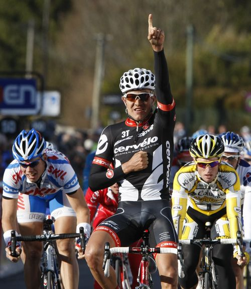 Cervello rider Heinrich Haussler of Germany holds up his arm as he celebrates winning the second stage of Paris-Nice cycling race between Saint Brisso...