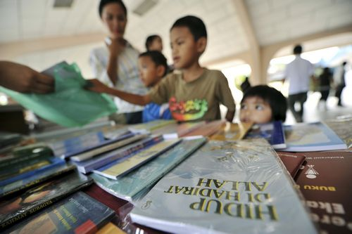 A Christian book entitled 'Live With the Presence of Allah' is on sale at St Francis Xavier Cathedral in Malaysia's eastern state of Sabah on Borneo i...