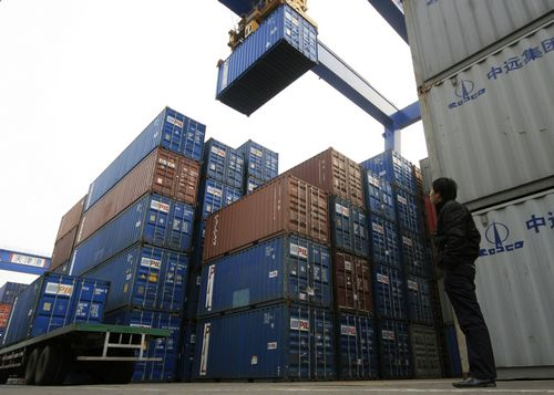 A man stands in front of containers at Tianjin Port in Tianjin, China yesterday.