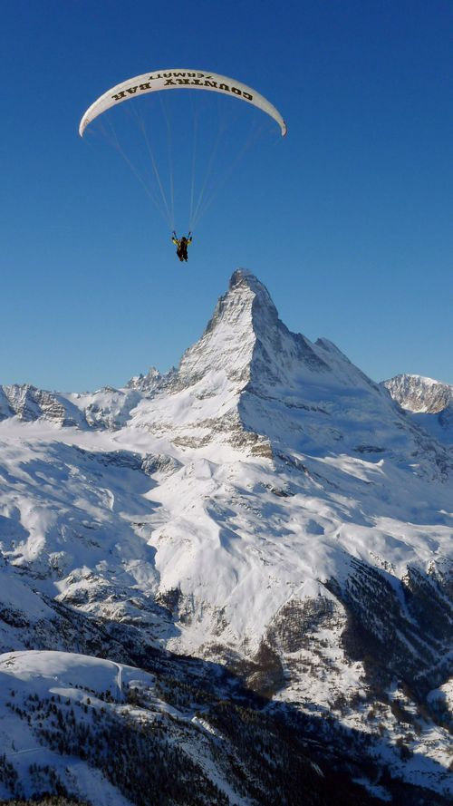Julie Behr and Bruno Schmid paraglide in Zermatt, Switzerland as the Matterhorn can be seen in the background. (Alan Behr/MCT)