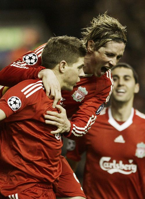 Liverpool's Steven Gerrard, left, celebrates scoring against Real Madrid with Fernando Torres, center, during their Champions League soccer match in L...