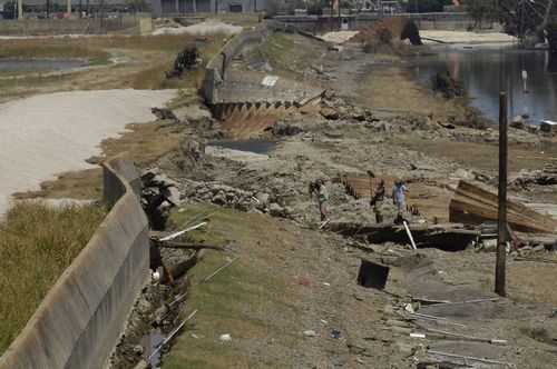 A film crew documents the levee breech along the industrial canal near Arabi, Louisiana following Hurricane Katrina's landing in New Orleans in this S...