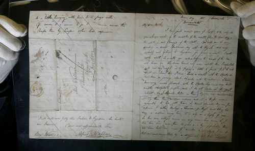 Dr. George Beccaloni Curator of Orthopteroidea holds up a letter written by A. R. Wallace from Sarawk home to England dated 1855,in the Rare Books Roo...