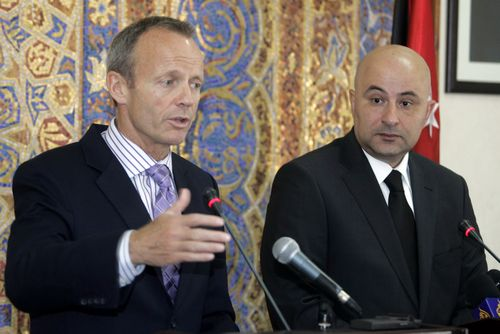 Canadian Minister of International trade Stockwell Day, left, and Jordanian Minister of Industry and Trade Amer Hadidi, right, speak during a press co...