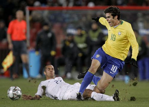The U.S.' Benny Feilhaber, left, vies for the ball with Brazil's Kaka during their Confederations Cup final soccer match at Ellis Park Stadium in Joha...
