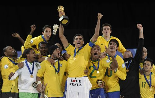 Brazil's Lucio, center, holds up the Confederations Cup trophy with fellow team members after defeating the U.S. in their Confederations Cup final soc...
