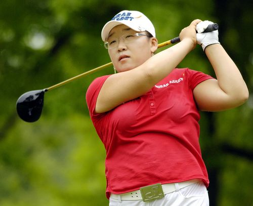 Jiyai Shin, of South Korea, tees off on the eighth hole during the final round of the LPGA Wegmans golf tournament at the Locust Hill Country Club in ...