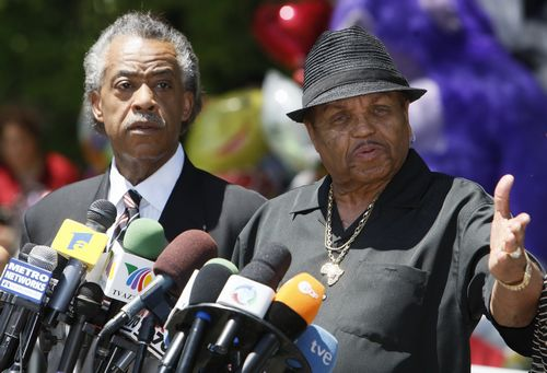 Rev. Al Sharpton and Joe Jackson, Michael Jackson's father, speak at a news conference in front of the Jackson family residence in Encino, California ...