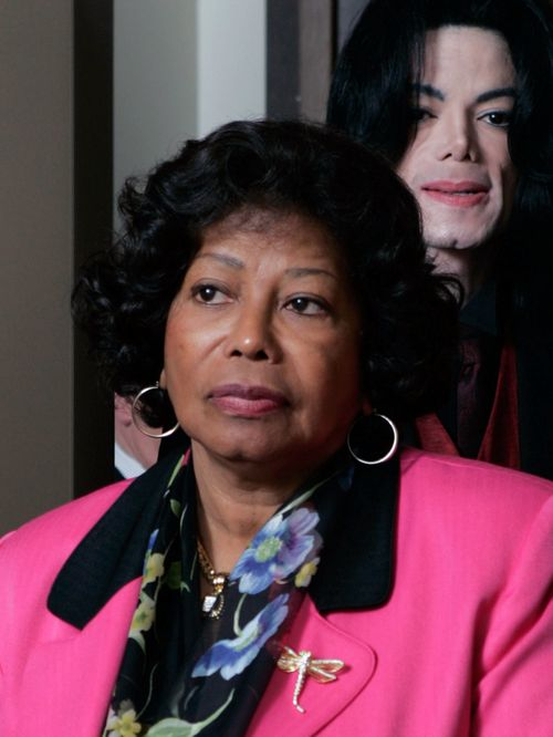 Michael Jackson, background, and his mother Katherine Jackson are seen passing through a security check point on the way to his child molestation tria...